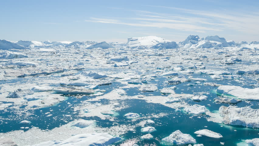 Iceberg from glacier in arctic ice nature landscape on Greenland. Aerial video footage of giant icebergs in Ilulissat icefjord. Affected by climate change and global warming. | Shutterstock HD Video #31528360