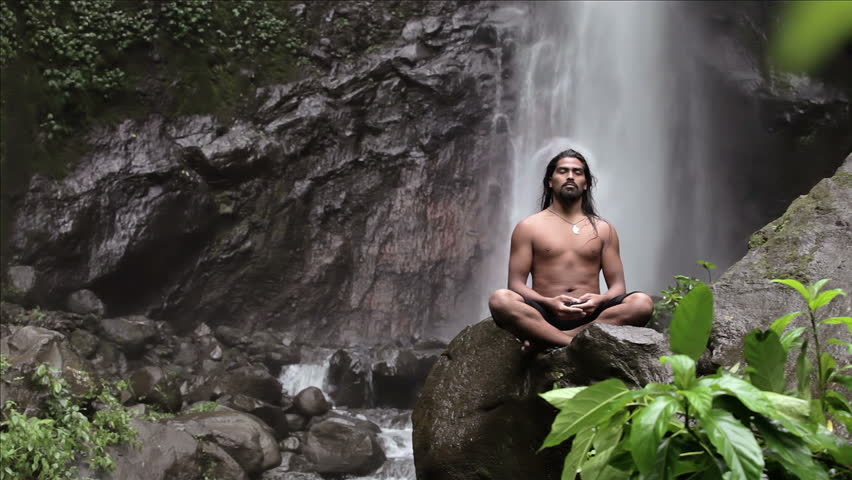 man doing sitting meditation at waterfall in the tropics #3153070