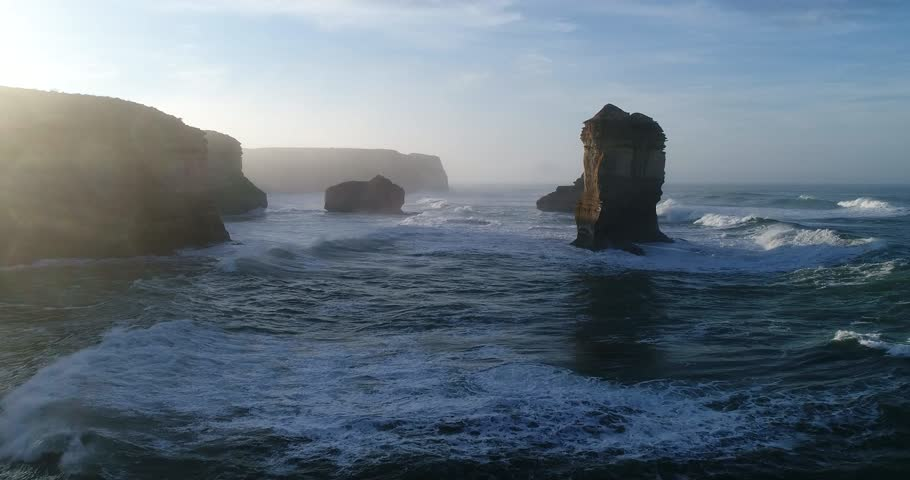 Between rock formation apostles off australian coast on Great Ocean road low under stormy waves.  | Shutterstock HD Video #31536760