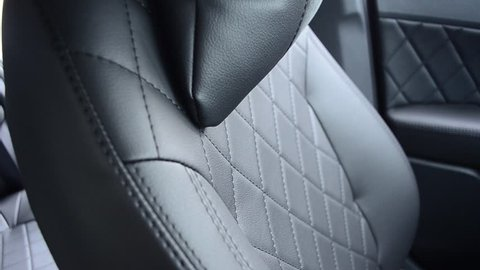 Black leather seat covers in car.