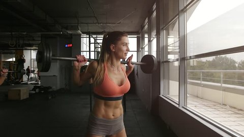 Beautiful sexy girls working out in modern gym club as part healthy lifestyle.