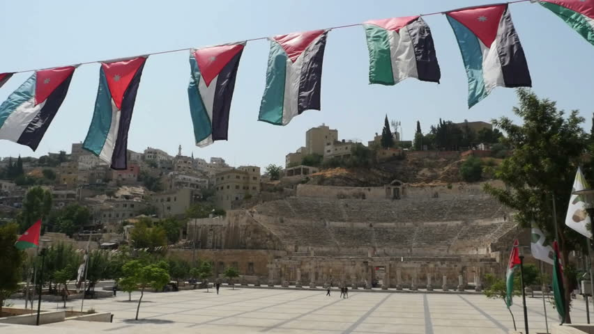 Jordan flags waving in the wind at the colosseum in Amman #31594993