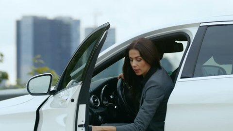 Business Woman Gets out of Her Premium Class Car and Goes to Her Business Meeting with Important Investors. Shot on RED EPIC-W 8K Helium Cinema Camera.