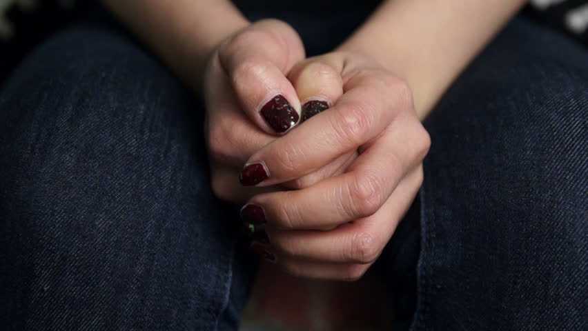 Stressed hands of a young woman
