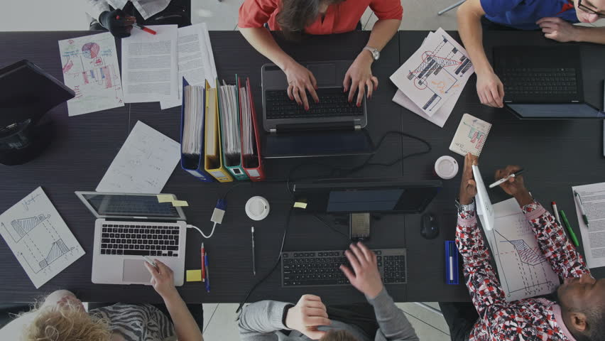 Top view of workers at the desk in the office. Group of busy employees collaborating and working efficiently on the business development. | Shutterstock HD Video #31615990