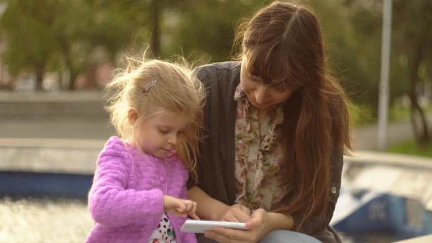 Little Girl With Mother In Park Playing Squirting Water From A Fountain Stock Footage -8695