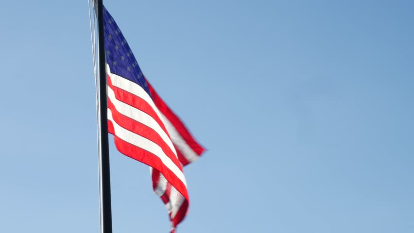 American Flag Blowing the Wind Isolated on Blue Sky #31651687