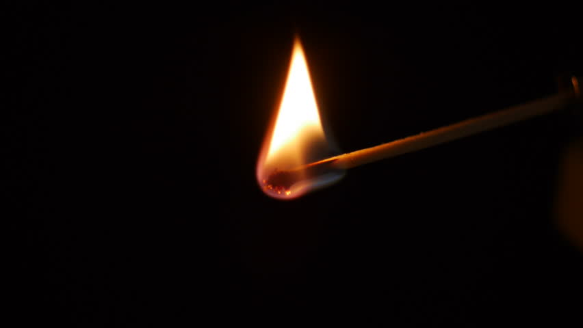 Slow motion of lighting a match with black background
