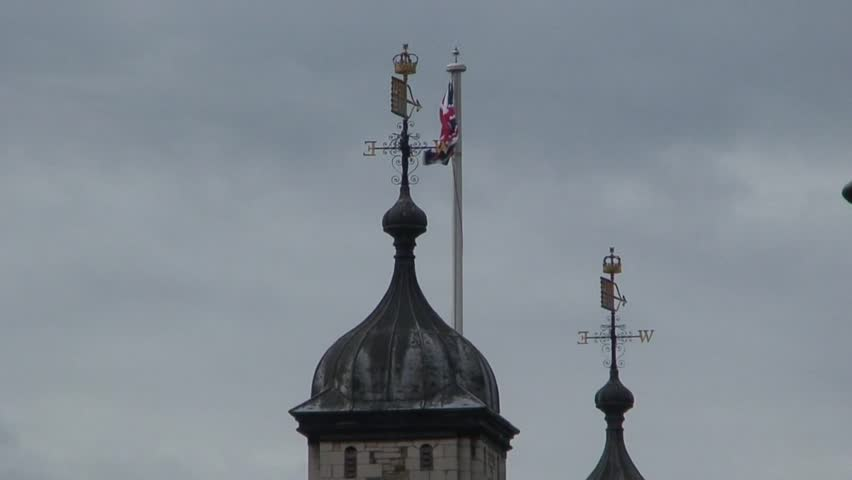 British flag flying above a tower at the Tower of London.