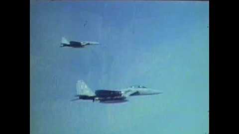 CIRCA 1977 - A McDonnell Douglas F-15 Eagle twin-engine tactical aircraft dogfights with a Northrop F-5E supersonic light fighter in an aerial combat maneuvering test