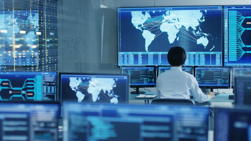 In the System Control Room Operator Sits at His Workstation with Multiple Displays Showing Graphics and Logistics Information. Shot on RED EPIC-W 8K Helium Cinema Camera. | Shutterstock HD Video #31712050