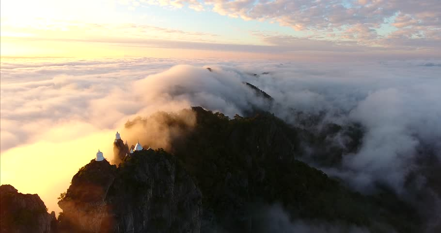 Unseen Thailand. Aerial view over beautiful clouds. Wat Chalermprakiet on the misty mountain at Lampang province, Thailand