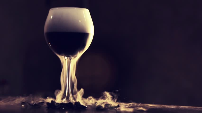 Red wine in glass with dry ice