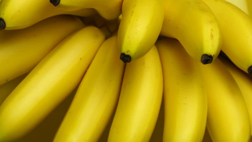 Bananas. A bunch of bananas rotates, an interesting foreshortening, an advertising shot. | Shutterstock HD Video #31735330