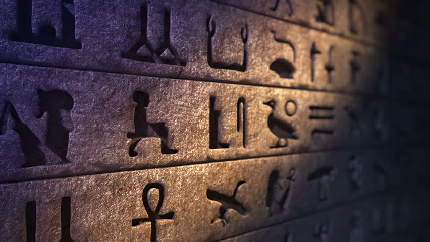 Old egyptian hieroglyphs on the rock wall. Stone wall ancient writings footage. Loopable