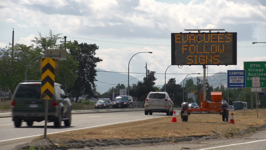 LED Road Sign: Evacuees Follow Signs - Extreme Fire Hazard - Please Use Caution. Along highway during extreme fire season in British Columbia. Vernon, BC. Med Shot | Shutterstock HD Video #31820320