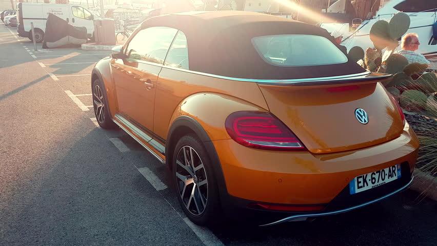 Menton, France - October 15, 2017: Beautiful Volkswagen Beetle Dune Convertible (Rear View) Parked on Port Garavan in Menton on the French Riviera - 4K Video