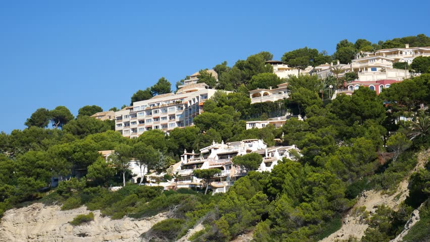 Authentic Spanish houses on a mountain clif in Cala Pi Mallorca Spain