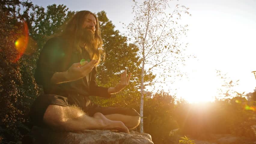 Yogi Meditating on sunset #31857250