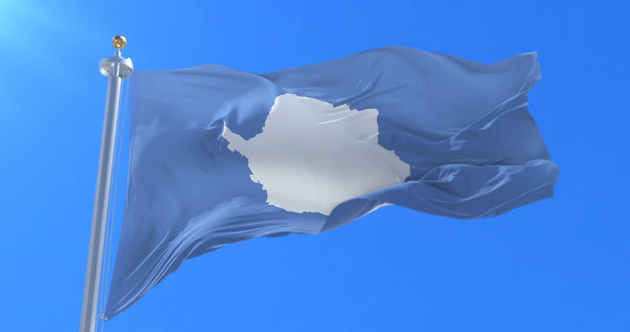 Flag of Antarctic continent waving in slow with blue sky, loop | Shutterstock HD Video #31865950