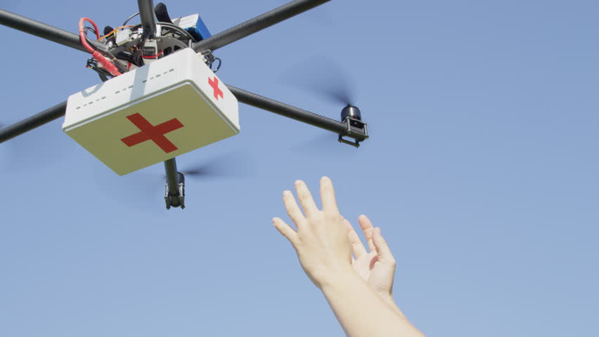 CLOSE UP: UAV aerial drone delivery. Multicopter flying with first aid medicine package. Person' arms receiving first aid SOS delivery drone from sky. Medical air shipment by first responder drone | Shutterstock HD Video #31866340