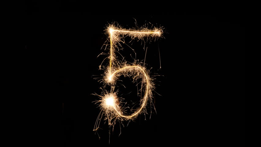 Sparkling numbers countdown from 9 to 0 made with sparklers. 4k, stop motion animation.