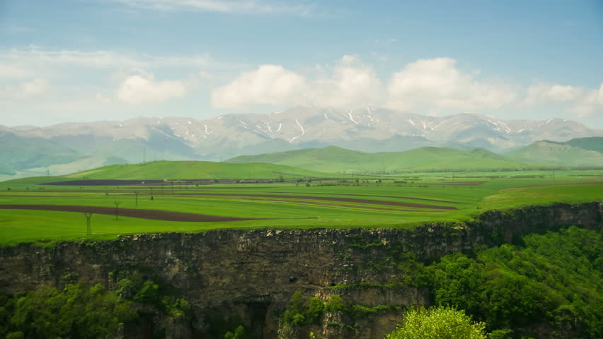 Landscape view of the Canyon, Gorge, Stream and Mountains of Armenia. Time Lapse. Summer, Sunny day, green trees, clouds over the mountains. #31870960