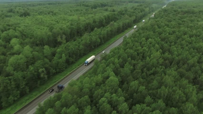 Trucks driving / traveling on the forest asphalt road aerial footage / top view / Highway truck traffic | Shutterstock HD Video #31896700