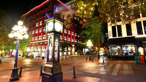Vancouver BC, Canada - September 25, 2017 :Time lapse wide shot of the Stream Clock the hour in Vancouver's historic Gastown district , Gastown Steam Clock built by Saunders in 1977