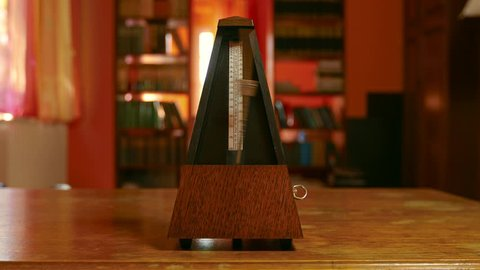 Classic metronome clicking in warm toned light
