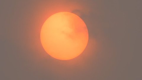 Sunlight obscured by Sahara dust and wildfire smoke moving from left to right.