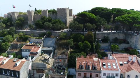 Aerial of Sao Jorge Castle in Portuguese Castelo de Sao Jorge is Moorish castle occupying hilltop overlooking historic centre this strongly fortified citadel is one of the main tourist sites of Lisbon