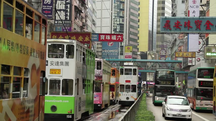 HONG KONG,CHINA :Trams and Buses travelling up and down Causeway Bay, Hong Kong, China. CIRCA 2011.
