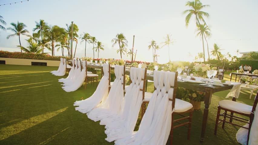 wedding reception set outdoors under bright sun on resort hyatt,island maui,hawaii