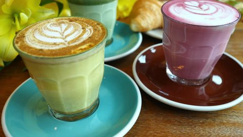 Colorful Hipster Coffee With Croissants For Breakfast In Coffee Shop. Closeup. 4K.