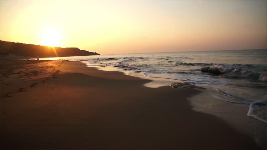 Waves after sunrise on Golden Beach in Karpass Peninsula, Cyprus