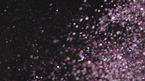 Realistic Glitter Exploding on Black Background. These clips are perfect for visual effects, compositing, and motion graphics. Use blending mode (screen).
