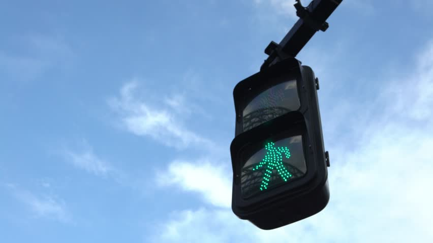 4K Asian pedestrian crosswalk sign Tokyo city traffic green light illuminated with blue sky in a beautiful day. Cross road intersection street Japan. Asia downtown metropolitan-Dan
