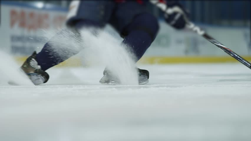 Ice hockey. Close-up of hockey skates. The hockey player does the braking on the ice. | Shutterstock HD Video #32052640