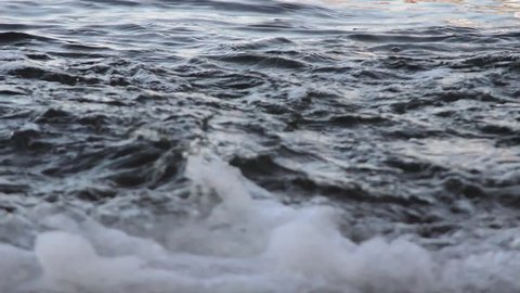 closeup of small waves on slipway