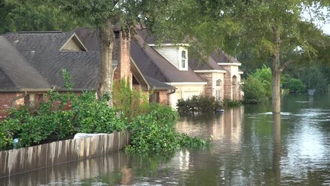 Houston, Texas - United States - August 27, 2017: Many flooded houses on road side in Texas during Harvey