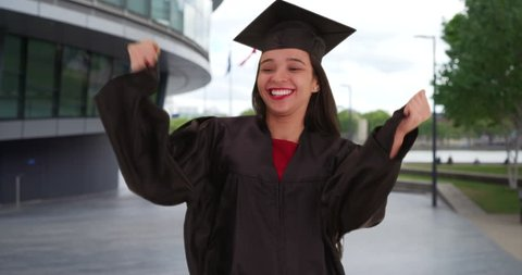 Young Latina graduate joyously receives her long-awaited college diploma. Very happy Hispanic woman treasures her hard-earned diploma in London, England. 4k