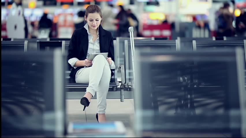 Pretty young female passenger at the airport (shallow DOF; color toned image) | Shutterstock HD Video #3215830