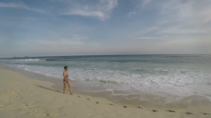 Woman on the beach of Barra da Tijuca in Rio de Janeiro   Shutterstock HD Video #32192770
