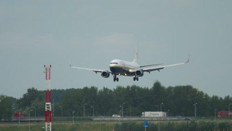 AMSTERDAM, THE NETHERLANDS - JULY 27, 2017: TUI Airlines -Miami Air International- Boeing 737 N732MA landing at runway 18R Polderbaan. Shiphol Airport, Amsterdam, Holland