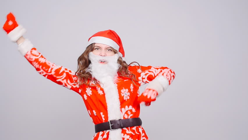 A young woman Santa Claus is dancing | Shutterstock HD Video #32217190