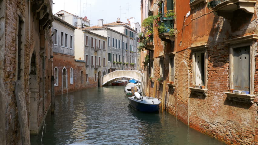 VENICE, ITALY, SEPTEMBER 7, 2017: Water Canal of Venice, Italy. Narrow Streets of Venice. Water transportation, gondola, boats. Architecture buildings of Italy. | Shutterstock HD Video #32226613