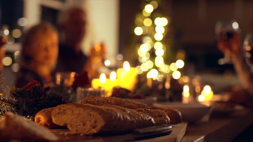 Family toasting wine at christmas dinner. Family enjoying christmas dinner together at home, with focus on hands and wine glasses.  | Shutterstock HD Video #32229790