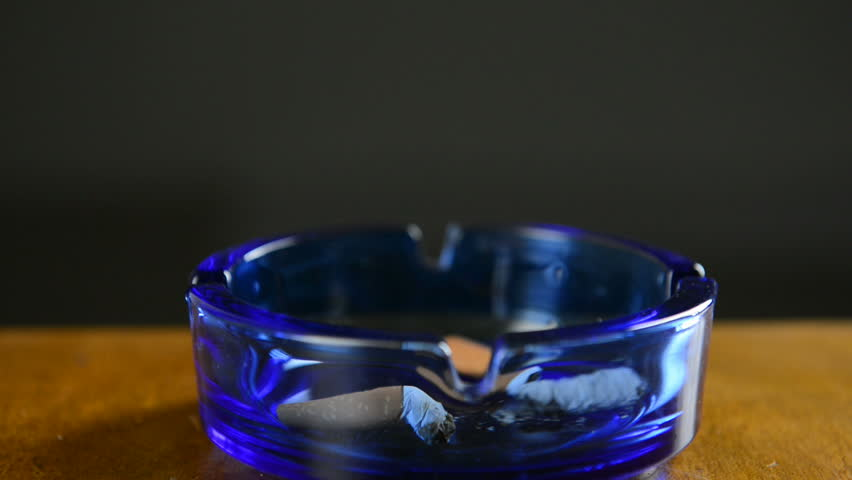 HD1080p: Putting out a cigarette. Hand puts out a cigarette in an ashtray