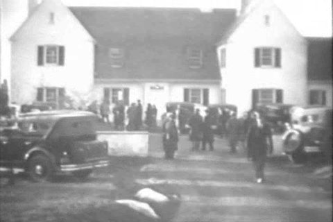 CIRCA 1930s - Police search for kidnapped Charles Augustus Lindbergh Jr. in Hopewell, New Jersey and a house has exploded in Chicago, Illinois, in 1932.